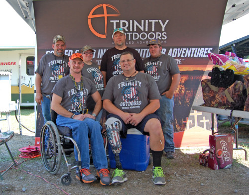 Some of the team of Trinity Outdoor Disabled Adventures that was hosting a booth at the recent Gueydan Duck Festival. Back row, L. to r. Frank Miller, Lori Credeur, Gerard Credeur, Scott Miller. Front row - L. - Matthew Matherne and ministry founder Jason Bland. Photo by Mark H. Hunter