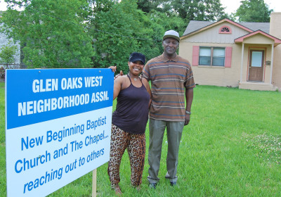 Glen Oaks homeowner Glynnitra Ellzey and the Rev. Donald Hunter, Sr., stand in front of Ellzey's home that received a new roof thanks to a partnership with Hunter's small New Beginning Baptist Church and the much larger Chapel on Campus. photo by mark h hunter