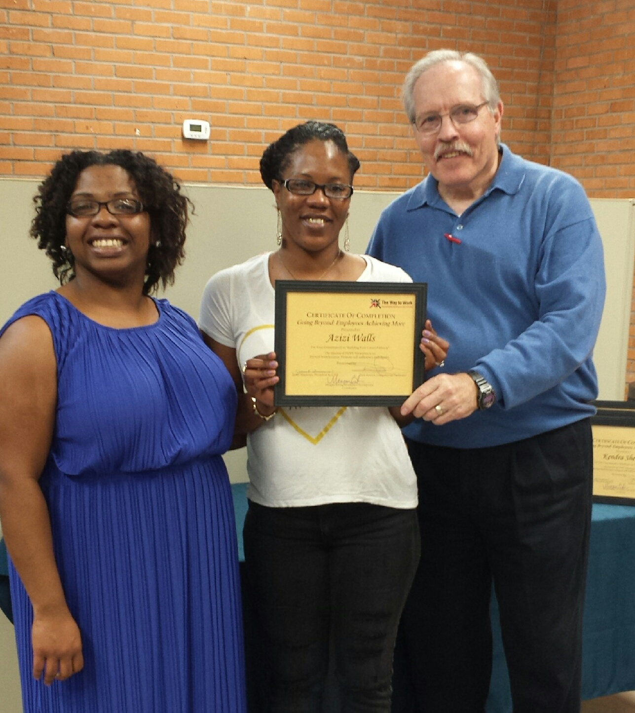 Aziz Walls, center, recently graduated from the Going Beyond program. She is pictured here with Megan Belvin, HOPE Workforce Development Coordinator, left, and Dick Stonich, HOPE Family Services Financial Trainer.