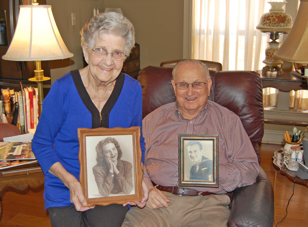 "Bess and J.O. ""Duck"" Greer hold photos of themselves in 1947, the year they were married. After 68 years of married bliss, ""we even think alike,"" she said. photo by mark h hunter"