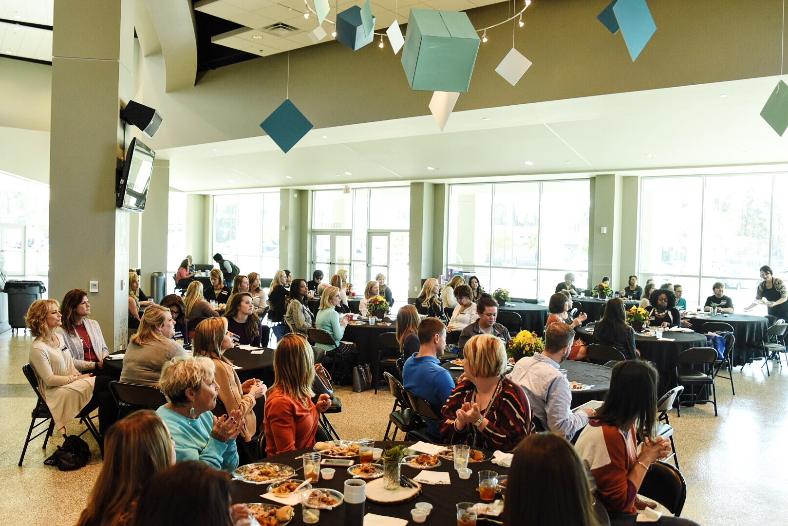 Attendees enjoy lunch and a guest speaker at a local Propel Women meeting.