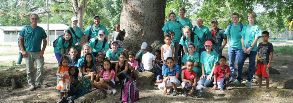 The CVM group poses with villagers during last year's trip to Honduras.