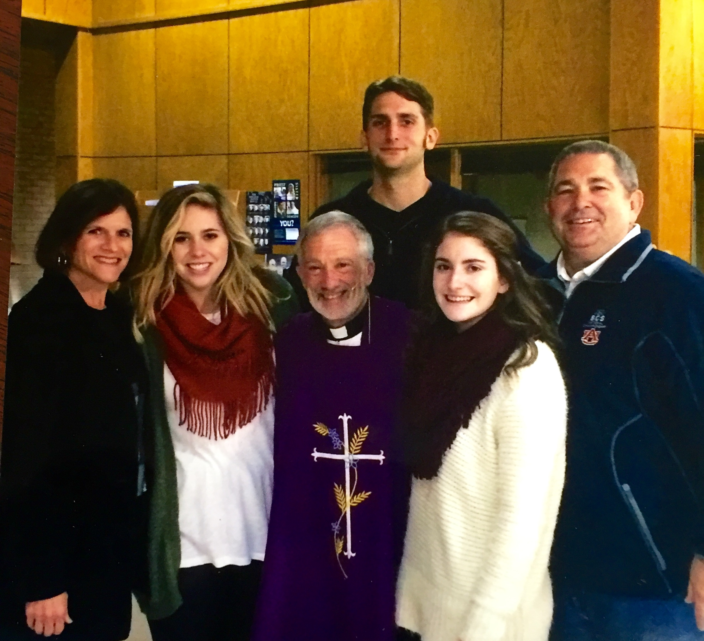 Tex with wife Cindy, children Claire, Noelle and Joshua, and Father Martin.