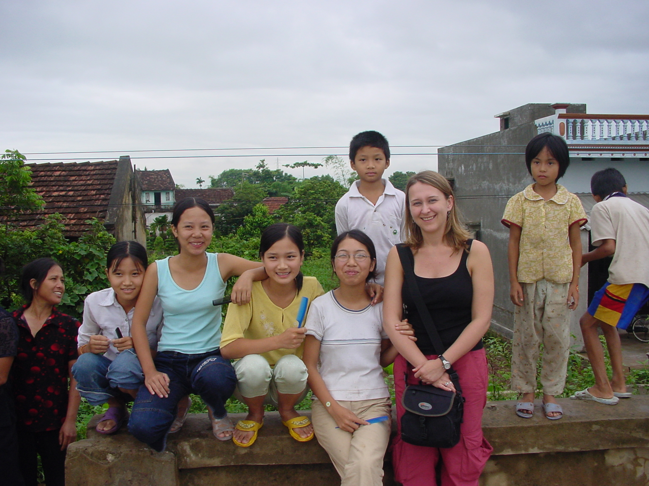 Sherri poses with a group of young girls in Southeast Asia.