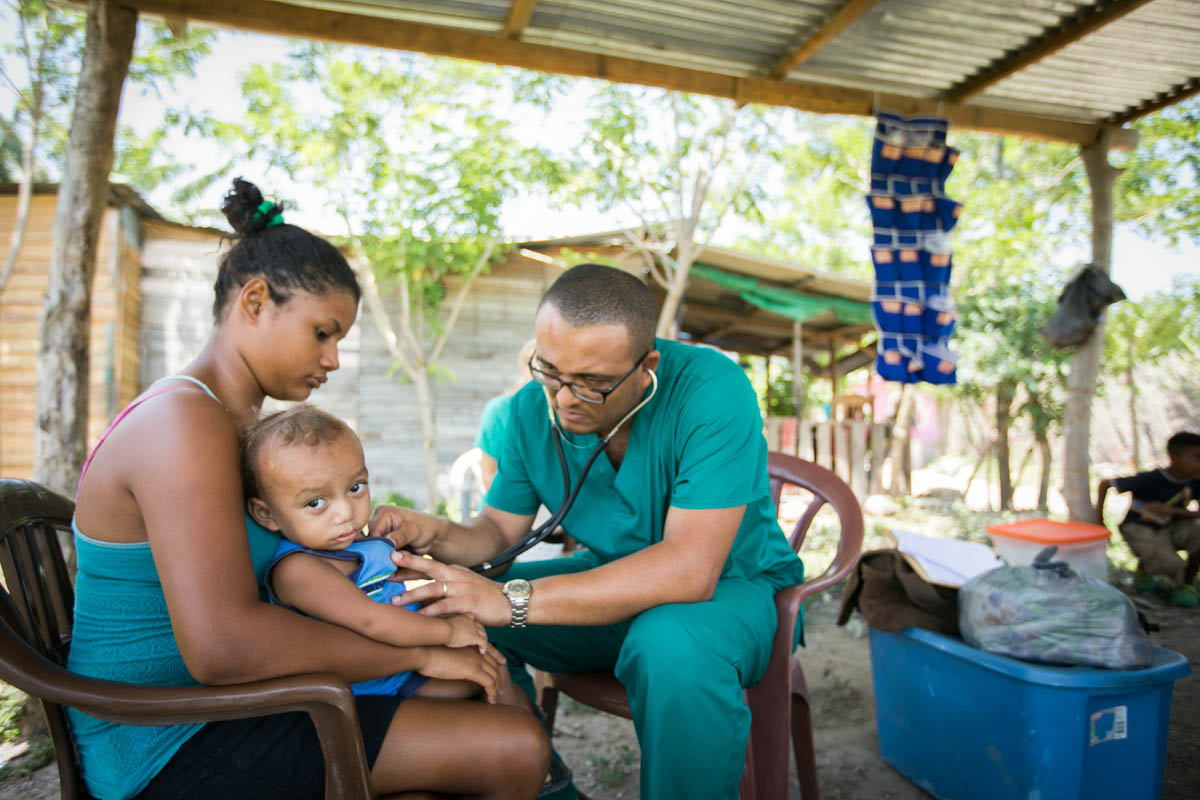 A doctor sees patients in a village near LaCeiba, Honduras.